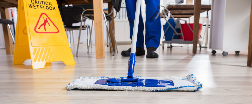 Professional cleaner mopping the floor in Tampa, FL